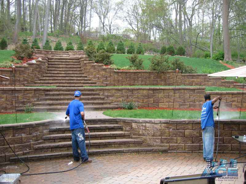 Power Washing Crews cleaning concrete retainer wall in Westwood, NJ