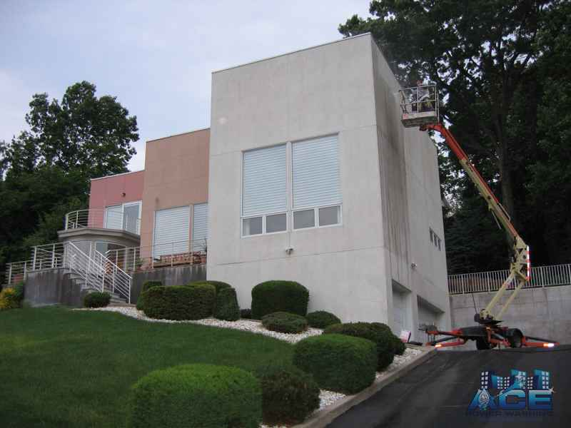 Exterior Cleaning of Stucco siding to remove rust and green mold in Montvale, NJ