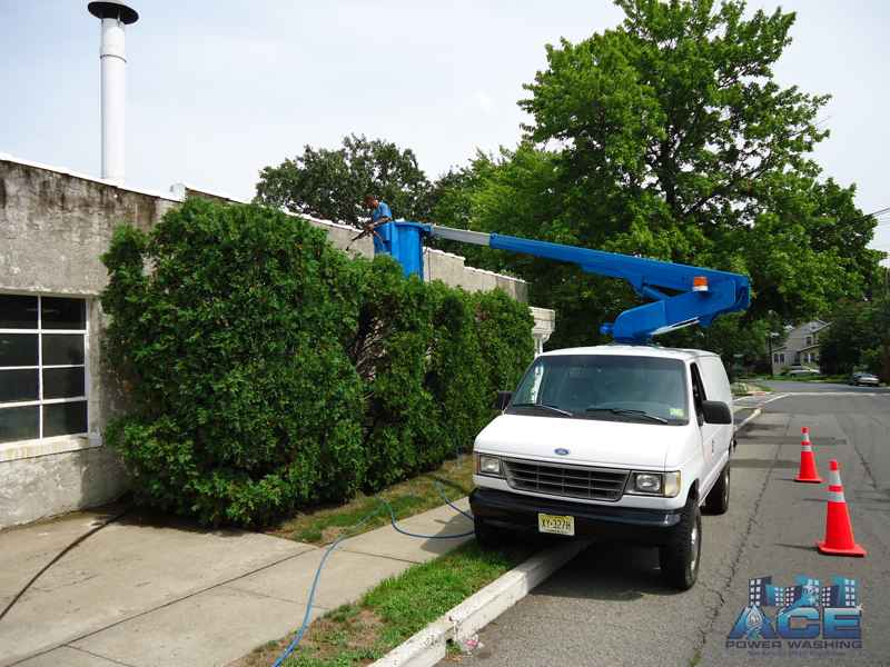 Exterior Building Power Washing using our lifts in Edison, NJ